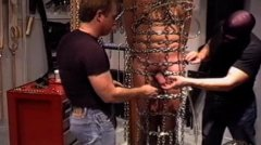Cbt Orgy Bottom Suspended And Caged In Chains While 3 Guys Use A
