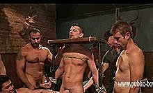 Man Is Bound In A Medieval Device Tied Up And Forcefully Jerked Off By Dominatig Men