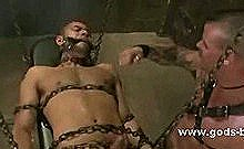 Huge Gay Master With A Body Of A Beast In Leather Outfit Abuses Slave Bound In Chains And Hanged